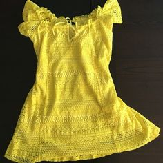 New Topshop Yellow Dress This dress is lined with an adjustable tie around the top. The sleeves are capped. I have the tag on from the store I got it from. It doesn't have a Topshop tag so I didn't list it NWT. Topshop Dresses Mini