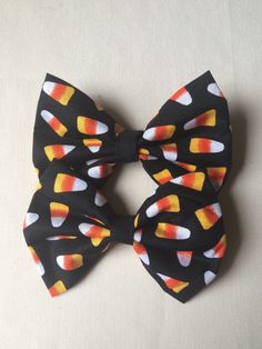 A personal favorite from my Etsy shop https://www.etsy.com/listing/246173732/mini-candy-corn-bows