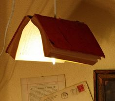 Lamp shade made out of a book.  I think you would need to be careful that the light doesn't catch the book on fire?