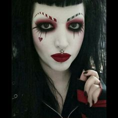 Drac Makens red and black (& a bit of white) make-up with striped eyebrows and a red heart accent