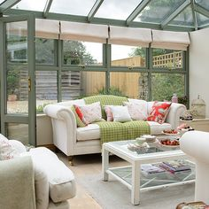 Green conservatory with cream sofas | Conservatory decorating | Style at Home | Housetohome.co.uk