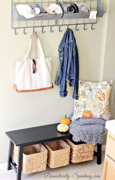 Where once there was no entryway, a place for coats and totes appears right before your eyes. Just add a 40-inch bench, a few baskets and a clever shelf. See more at Domestically Speaking »  - GoodHousekeeping.com