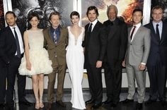 "The ensemble rises: from left, Tom Hardy, Marion Cotillard, Gary Oldman, Anne Hathaway, Christian Bale, Morgan Freeman, Joseph Gordon-Levitt and director Christopher Nolan at the premiere of ""The Dark Knight Rises"" in New York."