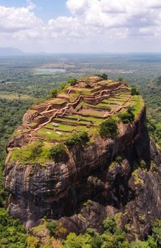 Sigiriya is a 1,600-year-old rock fortress in Sri Lanka that dramatically rises 660 feet above the forest floor