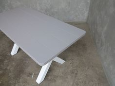 I love the colours that this table has been painted the grey and white compliment each other nicely.  The table top has been painted in a really smart grey colour which is quite unusual but I think it works really and it is very practical as the table top is protected with a layer of paint . For more information and pictures on our tables please do visit our website.