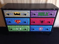 Doing something similar to this. modge podging the front of the drawers with super hero wrapping paper.