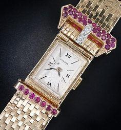 Retro buckle bracelet watch with diamonds and rubies. Circa 1940's. Via Diamonds in the Library....