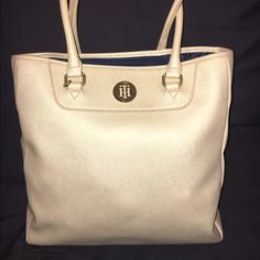 Tommy Hilfiger Bag This Tommy Hilfiger bag is a tan color that has a gold hint to it. It has only been worn once and is in great condition. It's about a small to medium size tote. The inside has a middle pocket and pockets on the walls of the inside. The material is a crosshatch leather. #tommyhillfigurepurse #goldpurse #tanpurse #bag #purse #tote Price is negotiable Tommy Hilfiger Bags Shoulder Bags