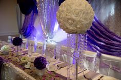 Purple lilac silver and Bling wedding decorations and table scapes diamonds and satin tablecape Bling Wedding Decorations, Table Scapes, Purple Lilac, Diamonds, Chandelier, Wedding Photography, Satin, Ceiling Lights, Silver