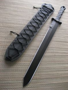 "Miller Bros. Blades Custom M-16 Tactical Sword. 24"" Blade, Double Handed, Kydex sheath. This sword has a custom tip profile and jimping on the spine near the handle."