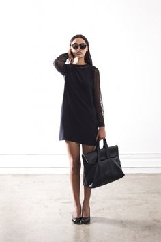 Minimal black dress, flats and carry-on bag for in flight dressing / the love assembly