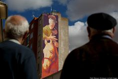 A giant Don Quixote graffiti mural painted today by Chilean graffiti artist Inti on the wall of a building on April 5, 2014 in Quintanar de la Orden, Spain.