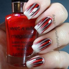 Let your nails give a statement with this powerful Ombre nail art design. Combine strong colors such as black, red and silver with frosted white tips to give out the perfect effect.