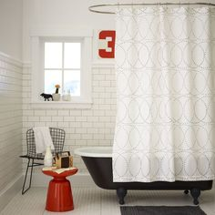 The Nile Shower Curtain's intertwining circles, made up of tiny dots, are inspired by traditional African patterns. The delicate design goes equally well with modern tiles or traditional tubs.