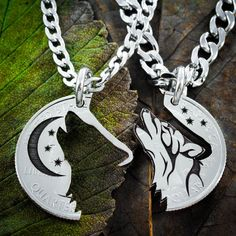 These Wolf necklaces form a pair that fits together perfectly. It has been engreaved to provide the details, then cut by hand to come apart. You get two necklaces showing the howling wolf. This is cut by hand from a quarter and comes with two high quality stainless steel chains or key