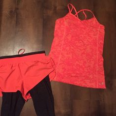 Medium athletic Tank Great condition! Coral tank top with strappy back. Size medium BCG. Tops Tank Tops