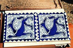 Azulejos azules con figuras de animales colores azul cobalto. Dimensiones : 15 x 15 cm  Año 2014 .  D .M.G