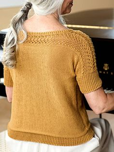 Grab a few hanks of Berroco Modern Cotton DK to knit your own Diane sweater! The soft, machine-washable blend of Pima cotton and Modal® rayon are a perfect fit for this summer-y tee, knit from side to side with a simple lace stitch across the sleeves and neck.