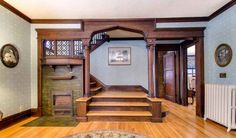 Ogee arched entry to stairway w/adorable fireplace in the corner.  1907 Tudor home in St. Paul, MN.