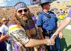 Willie Robertson from the TV show Duck Dynasty walks on the field before before an NCAA college football game between LSU and Florida. (Gerald Herbert/AP)