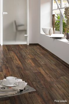 See design ideas and flooring options like this on our website: www.carolinawholesalefloors.com or check us out on Facebook!    Laminate wood-look flooring for tack room
