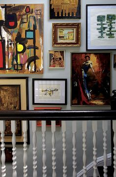 Eclectic art collection served as inspiration for a gallery wall.