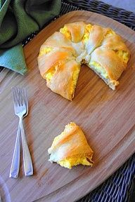bacon, egg, and cheese wrapped in crescent roll dough Ingredients 1 can of crescent rolls 5 large eggs; scrambled 1 cup of shredded Colby and Monterrey jack cheese 8 slices of cooked bacon (I bought the pre-cooked stuff) 1 teaspoon of season salt Directions 1. Heat oven to 375 degrees. Scramble eggs on stove top. Lay out crescents