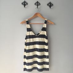J.Crew Navy / Cream Striped Sleeveless Top, Sz S J.Crew Navy / Cream Striped Sleeveless Top. Size small. Great condition. Perfect for that preppy nautical gal! I love pairing this with a fun colored denim, green is my fave! Contrast is where it's at! J. Crew Tops