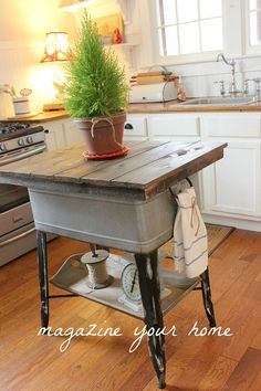 Wash Tub to Kitchen Island - Take an old washtub and turn it into a fabulous kitchen island. Add a wood plank top, a shelf and you have a ver…