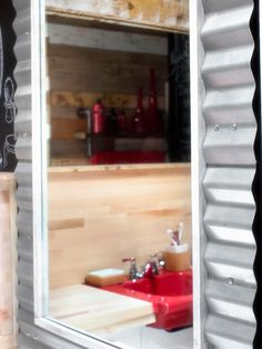 Thanks to clever repurposing, its use of reclaimed materials and a bold color palette, this 60-square-foot Tinseltown bathroom is ready for its closeup.