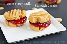 Soft melt-in-your-mouth Peanut Butter cookies sandwiched with berry jelly - Classic peanut butter jelly just got a make-over. Recipe from Roxanashomebaking.com