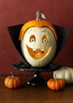 Thirsty Vampire Pumpkin DIY: Use carving tools and white and orange pumpkins to create this fun Halloween decoration and jack-o-lantern. Get the easy DIY idea and tutorial here. Pumpkin Face Carving, Funny Pumpkin Carvings, Pumpkin Art, Pumpkin Faces, Pumpkin Ideas, Pumpkin Designs, Funny Pumpkins, Halloween Pumpkins, Fall Halloween