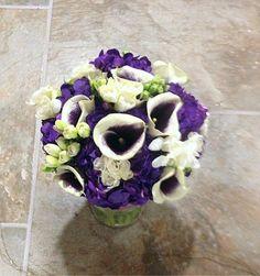 Bridal bouquet of purple hydrangea, freesia and mini calla lily