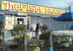 """The Fish House  was featured on the Food Network by Bobby Flay, and has been heralded by Fodor's, Zagat, Southern Living and Travel and Leisure.  This Key Largo landmark offers a variety of """"Conch style"""" cooking in a fun, casual atmosphere.  They specialize in fresh local seafood including yellowtail snapper, mahi-mahi, grouper, Florida lobster, and stone crab.  The Fish House also serves up delicious homemade Key Lime pie.  It is located at Mile Marker 102.4 on the oceanside in Key Largo."""