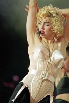 Madonna, 1990 Blond Ambition tour. Conical bra, corset by Jean Paul Gaultier. It popularized the look of innerwear as outerwear.