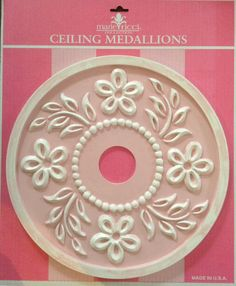 Ceiling medallions by Marie Ricci. Shown in distressed pink. Www.mariericci.com