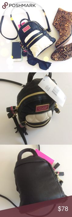Betsey Johnson mini Crossbody backpack I LOVE this backpack! I have one I carry on the daily! I use it as a Crossbody mini backpack. Long strap, long enough for us plus size lovelies! Many straps seem too short for plus size lovelies, but this one is great. Fits your essentials, wallet and phone. Lip essentials can be placed on the outside mini pocket! Love love! Betsey Johnson Bags Mini Bags