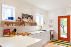 The kitchen is bright and opens up to the backyard.