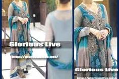 Beautiful Chiffon shirt with silver hand resham embroidery , It is adorned with zari work, dabka , the fabulous looking  on the top bodice...Grey crinkle chiffon frock gown with Blue shade features rich embellished on it...Dupatta in two shade with blue ribbon piping finishing...