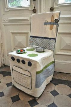 I love this! What a perfect solution for a play kitchen when you don't have room for one - fold it up and put it in a drawer when your done