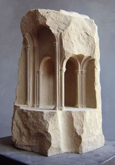 Sculptor Matthew Simmonds carves ancient architecture into marble and stone which seem to spring to life from the rocks, bringing with them a sense of life and significant space.