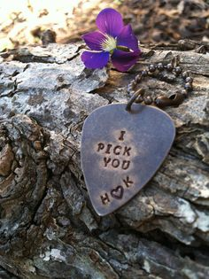 """A hand-stamped guitar pick keychain that says. """"I pick you"""" and two initials (of your choice) with a heart in between. This phrase is perfect for any couple whether dating, newly married, or married for 50 yrs. A great gift for wedding , Anniversary, or as a gift for spouse during Mothers or Fathers Days."""