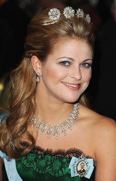 Princess Madeleine of Sweden at the Nobel Prize Banquet, 2009 wearing the Four Button Tiara, plus the Modern Fringe Tiara, also called Queen Silvia's Diamond Fringe Tiara, as a necklace.