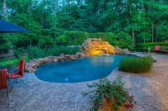 Estate home on 2.8 acres includes a waterfall pool with a cave, perfect for entertaining.