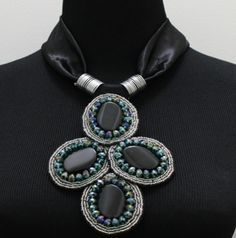 Our popular Belle medallion necklace - $89 made of black onyx stones with german crystals - definitely a customer fav