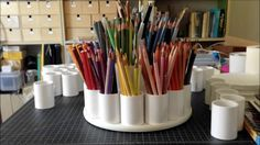 DIY Colored Pencil Caddy: This colored pencil organizer is gorgeous. I love the different tiers. It's on a lazy Susan, so it spins, and it's entirely made out of PVC couplers, so it's sturdy, too!