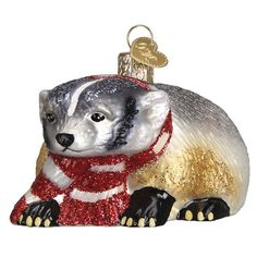 Badger: Badgers are known to be the world's fastest diggers. They move dirt faster than any other mammal, including a person with a shovel! Badgers dig in pursuit of prey and then expand tunnels into sleeping burrows. They are solitary, have a keen sense of smell, and are more active at night than in the day. Retail Price is $14.99 #OWCmidyearintro2015 #oldworldchristmas #12daysofchristmasinjuly #badger