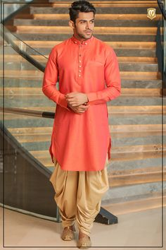 This vibrant orange pathani suit gives the right amount of finesse to any Indian man. It gets the royal attention one truly deserves in any Indian attire. pathani dress for mens, pathani kurta pajama for men, mens pathani suit, mens pathani, new pathani, pathani kurta for man, latest pathani design, kurta pathani, manyavar pathani suit, orange pathani, Fashion couture, indian couture, indian wear, indian wedding, ethnic wear for men, indian, traditional dresses.