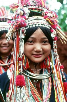 Asia   Portrait of a Akha girl wearing traditional clothes and headdress with silver balls, coins and pendants, Myanmar   © Richard K Diran