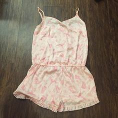 Forever 21 NWOT silky pink sleep romper- medium Forever 21 NWOT silky pink sleep romper- medium. This has never been worn. I actually thought it still had tags on, but I must've ripped them off and not remembered  Adorable French-themed print! Flexible price! Forever 21 Intimates & Sleepwear Pajamas